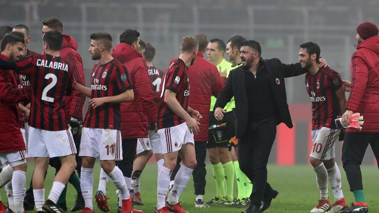 Milan celebrate their win over Lazio on Sunday at the San Siro