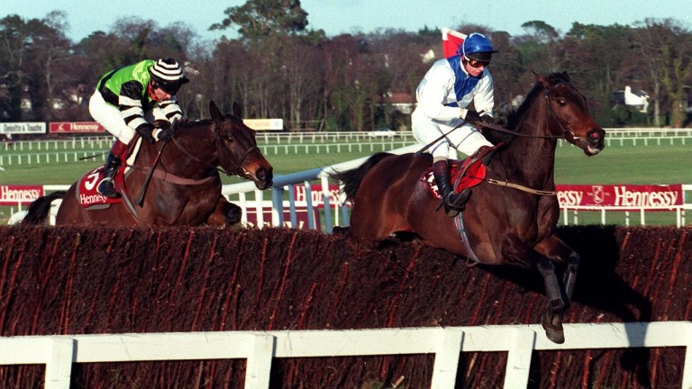 Danoli clears the final fence ahead of Jodami en route to landing the 1997 Hennessy Gold Cup