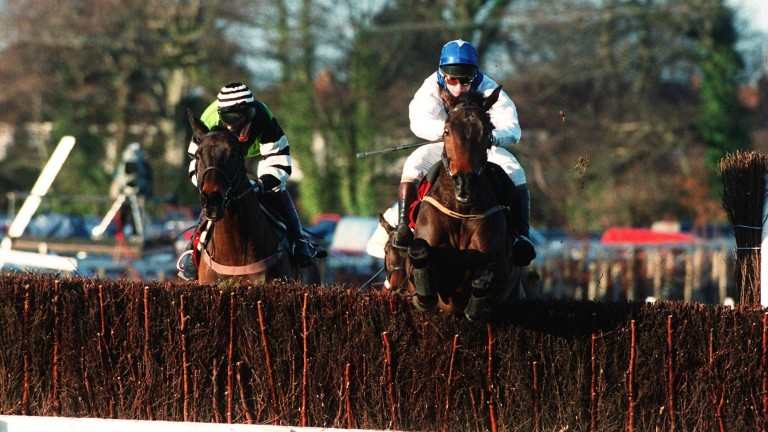 Horse racing: Danoli clears the final fence in the 1997 Hennessy Gold Cup under Tommy Treacy