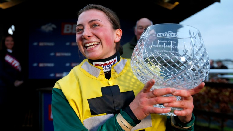Bryony Frost celebrates after winning the Betfred Classic Chase at Warwick on Milansbar