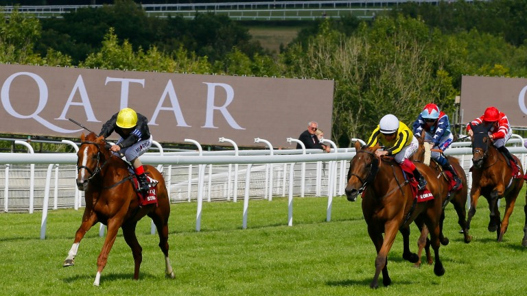 Stradivarius (Andrea Atzeni, left) beats Big Orange (Frankie Dettori) in the Qatar Goodwood Cup