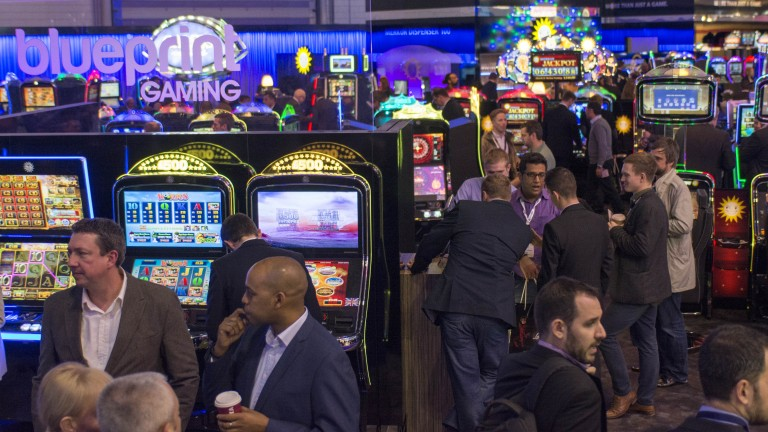 Middle-aged gaming executives roam the hall