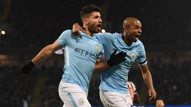 Man City hotshot Sergio Aguero (left) celebrates with Fernandinho
