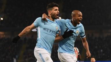 Man City hotshot Sergio Aguero (left) celebrates with Fernandinho