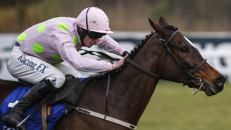 David Mullins pushes out Min for a convincing 12-length success in the Dublin Chase