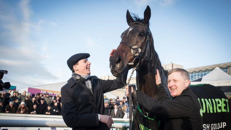 Joseph O'Brien gives Edwulf a well-deserved pat after winning the Irish Gold Cup