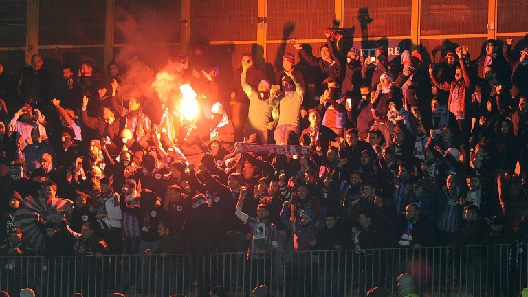 Trabzonspor's supporters cheer their team