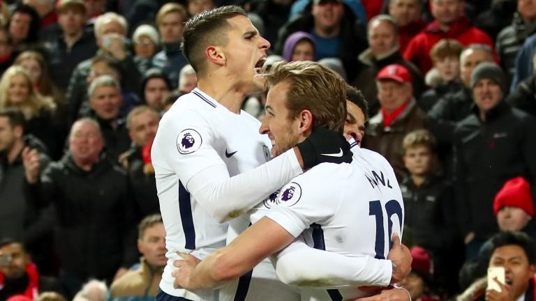 Harry Kane of Tottenham celebrates with teammates Dele Alli and Erik Lamela
