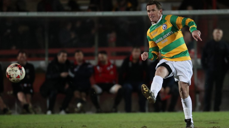 Sir Anthony McCoy shoots unsuccessfully in last year's charity football match against Cheltenham Town Legends