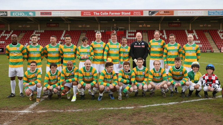 Sir AP McCoy's XI pose for a team picture before taking on the Cheltenham Town legends