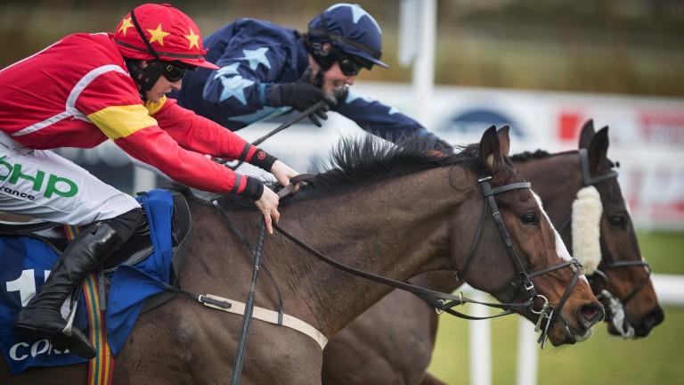 Patricks Park (near side) battles past Three Stars to score at the Dublin Racing Festival