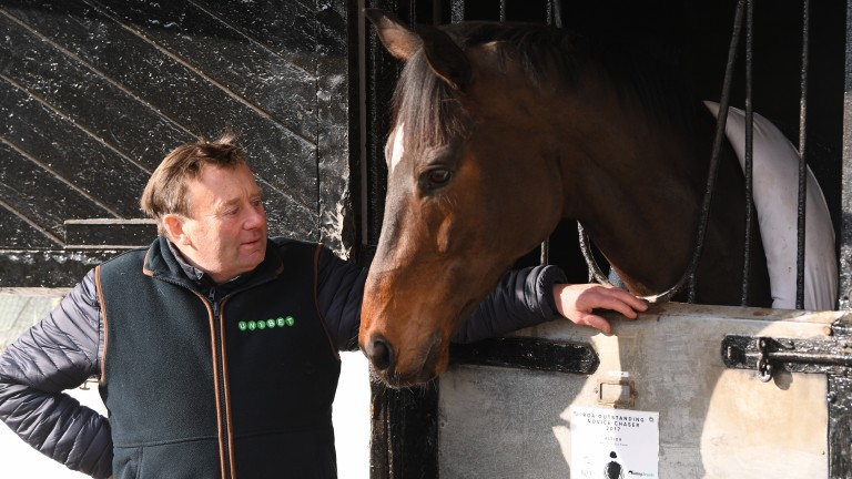 Nicky Henderson with wind op star Altior