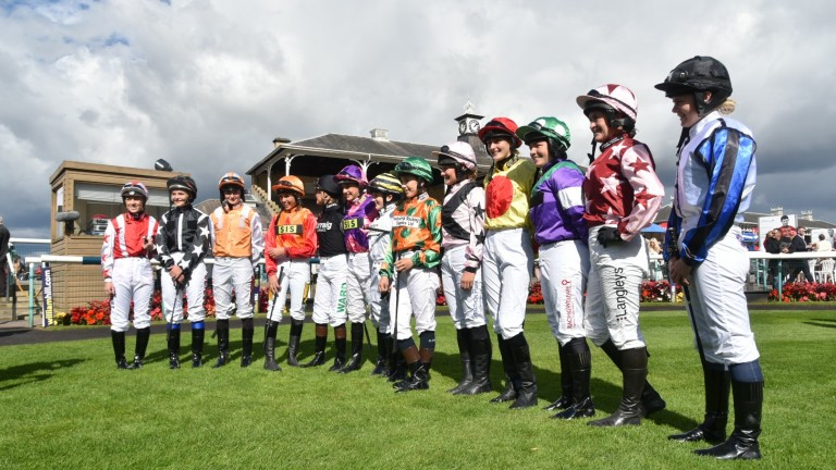 Jockeys pose in the parade ring ahead of a Silk Series race at Doncaster