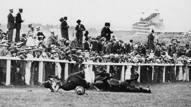 The aftermath of the dramatic intervention of Emily Davison in the 1913 Derby