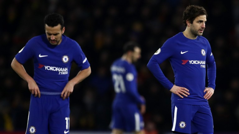 Pedro and Cesc Fabregas cut dejected figures after Chelsea's 4-1 defeat at Watford
