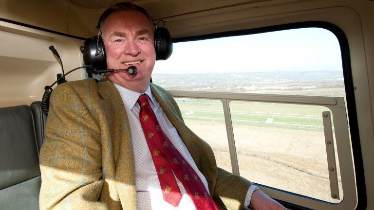 Dai Walters, pictured heading to Ffos Las in his helicopter, will maintain an association with the course as honorary chairman