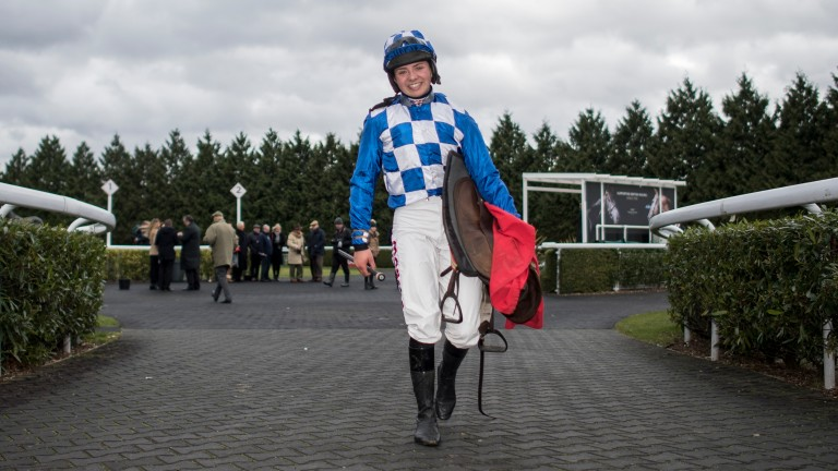 Bryony Frost, pictured after winning the conditionals' handicap hurdle at Kempton on Friday, is unlikely ever to be champion jockey says her boss Paul Nicholls