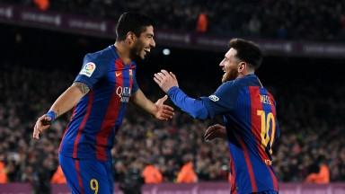 Barcelona's Lionel Messi celebrates with Luis Suarez