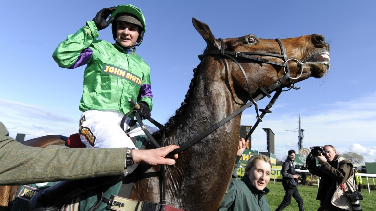 Liam Treadwell celebrates his 2009 Grand National victory on Mon Mome