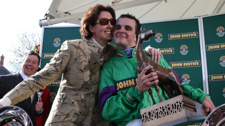 Liam Treadwell gets a hug from Venetia Williams after the pair's amazing 100-1 success with Mon Mome in the 2009 National