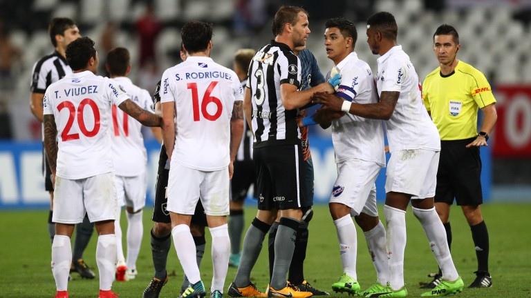 Nacional and Botafogo players get feisty in last year's Copa Libertadores last-16 tie