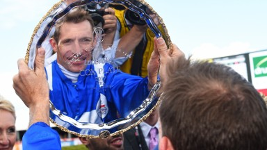 MELBOURNE, AUSTRALIA - OCTOBER 28:  Hugh Bowman poses with the plate after riding Winx to win Race 9, Ladbrokes Cox Plate  during Cox Plate Day at Moonee Valley Racecourse on October 28, 2017 in Melbourne, Australia.  (Photo by Vince Caligiuri/Getty Image