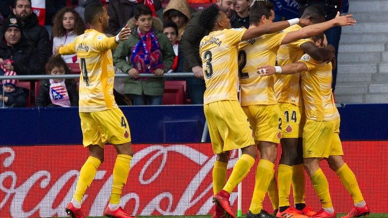 Girona celebrate a Cristian 'Portu' Portugues (right) goal at Atletioc Madrid