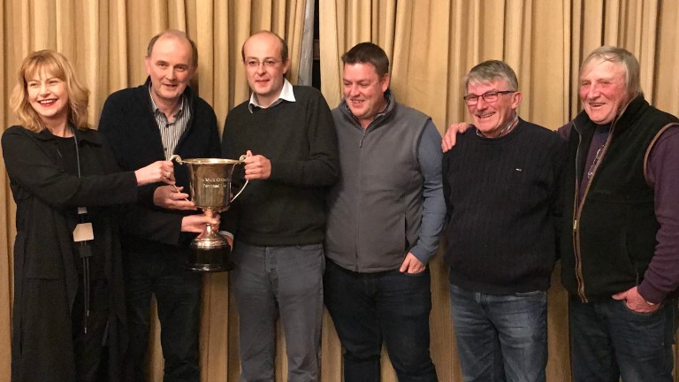 From left: Avril and Jim O'Hanlon present the winners' trophy to the victorious team of Ryan McElligott, Aidan 'Mouse' O'Ryan, Ger Connolly and Bobby O'Ryan