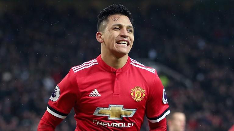 Alexis Sanchez celebrates his goal against Huddersfield