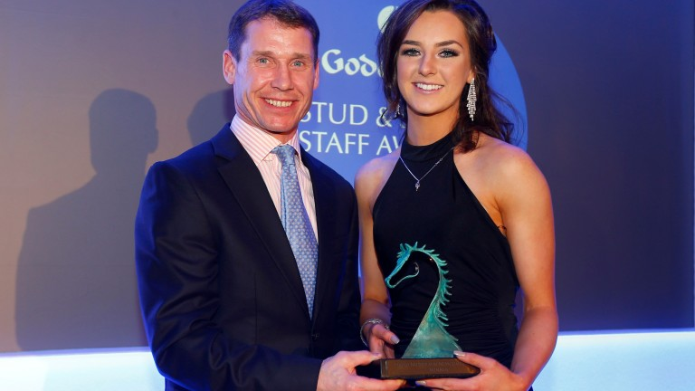 Richard Johnson presents Elisha Whittington with the David Nicholson Newcomer prize at the Godolphin Stud and Stable Staff Awards last February