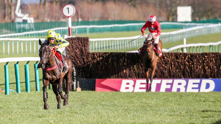 Yala Enki gallops up the run-in to win the Grand National Trial at Haydock
