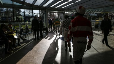 Jockeys ready: riders make their way out of the weighing room on an afternoon of mouthwatering action