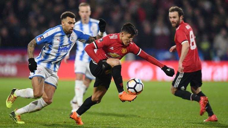 Manchester United beat Huddersfield Town 2-0 to set up an FA Cup quarter-final against Brighton & Hove Albion