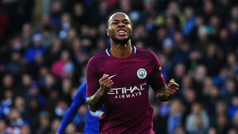 Raheem Sterling celebrates his goal at Cardiff