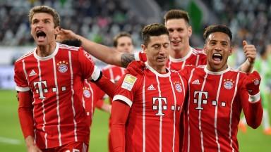 Bayern Munich celebrate Robert Lewandowski's winner at Wolfsburg on Saturday