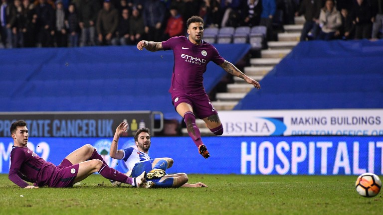 Will Grigg scores Wigan's winner against Man City