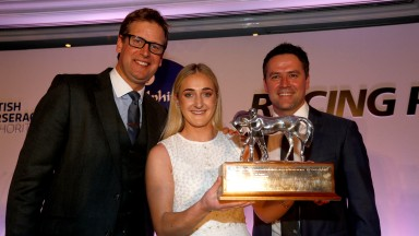 Jessica McLernon receives her trophy from Ed Chamberlin and Michael Owen