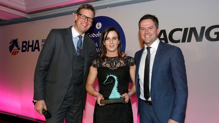 Sarah Taylor receives her prize from Ed Chamberlin and Michael Owen