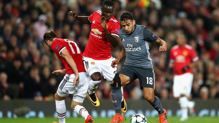 Eric Bailly (centre) of Manchester United tackles Benfica's Eduardo Salvio