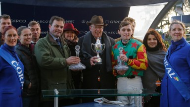 Andy Smith (brown trilby) and the other connections of Lil Rockerfeller receive the trophy after their November success at Ascot