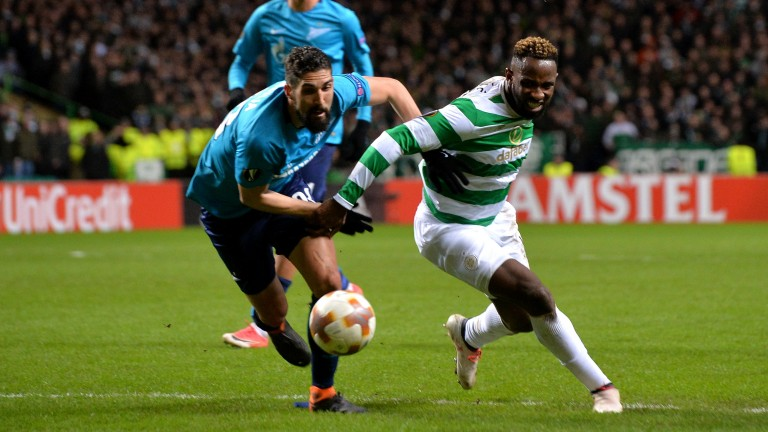Celtic's Moussa Dembele looks for a way past Zenit's defence at Parkhead