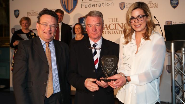 Nick Alexander (left) and Catch Bissett (right) receive their Team Champion award from Yogi Breisner