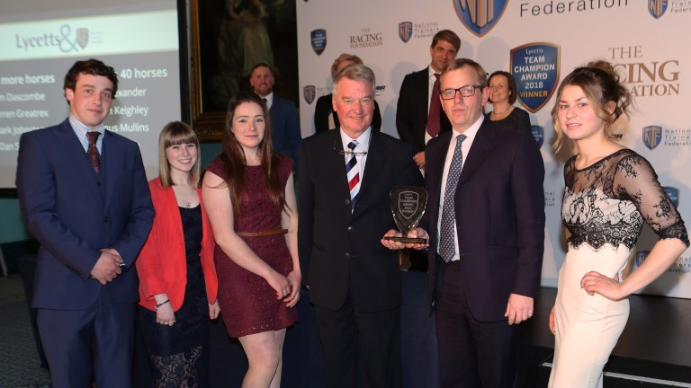 Warren Greatrex (second right) and team receive their Team Champion Award from Yogi Breisner