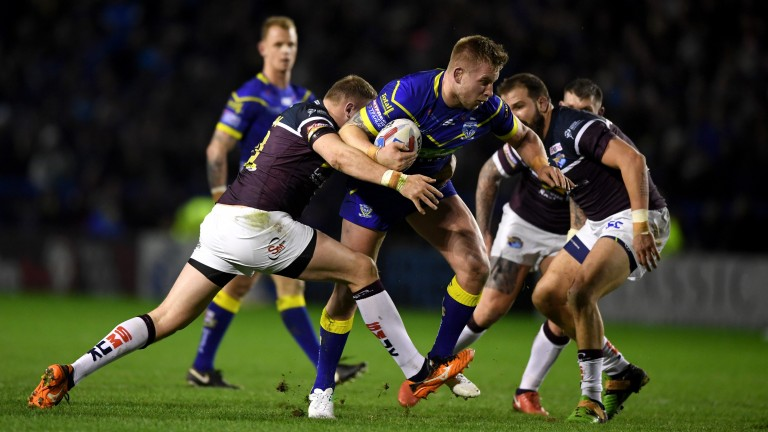 Warrington prop Mike Cooper looks for a way through the Leeds defence in round one