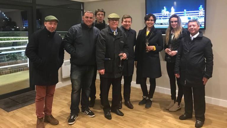 Paul Burgoyne (centre) celebrates Runaiocht's success at Kempton with family and friends, including former jockey Richard Quinn (right)
