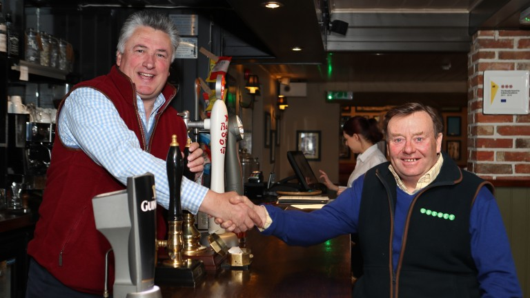 Champions: Paul Nicholls and Nicky Henderson meet up for a pre-festival drink