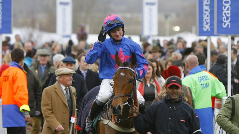 Cue Card and Joe Tizzard return to the winner's enclosure following their Champion Bumper victory