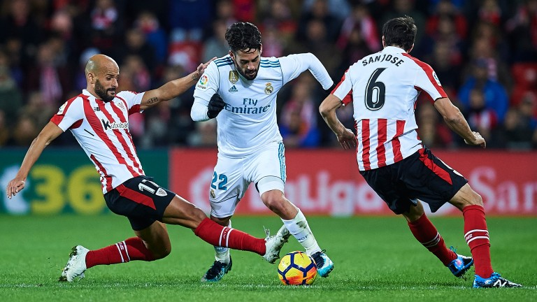 Athletic Bilvao's Mikel Rico slides in on Real Madrid's Isco