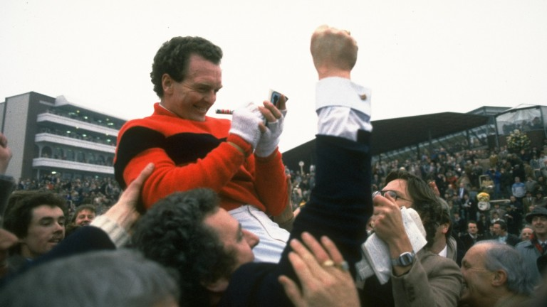 Jonjo O'Neill signs autographs while aloft on fans' shoulders after winning the Gold Cup on Dawn Run – the mare remains the only horse to have completed the Champion Hurdle/Gold Cup double