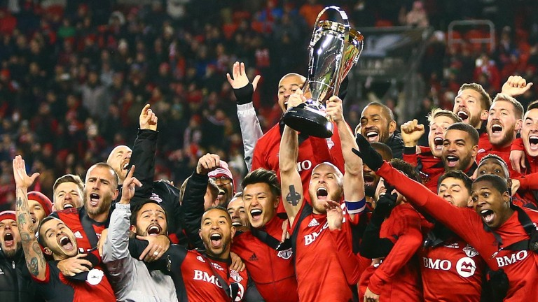 Michael Bradley lifts the MLS Cup for Toronto FC